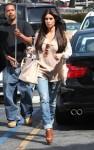 12 pink Kim Kardashian a peek-a-boo bag